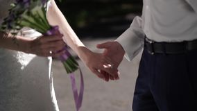 Bride and groom holding hands stock video footage