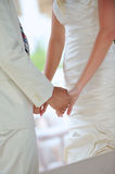 Bride and groom holding hands at wedding Royalty Free Stock Photos