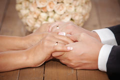 Bride and groom holding hands. Stock Photography