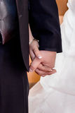 Bride and groom holding hands during wedding ceremony Stock Images
