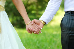 Bride and groom holding hands on wedding ceremony Royalty Free Stock Image