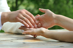 Bride and groom holding hands Stock Photography