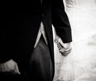 Bride and groom holding hands in wedding marriage ceremony Royalty Free Stock Photo