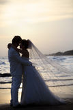 Bride and groom holding and hug at sea side in dus Stock Photos