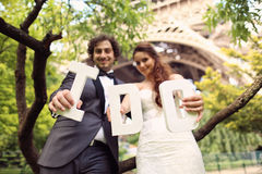 Bride and groom holding I DO letters Royalty Free Stock Photo