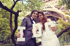 Bride and groom holding I DO letters Stock Image