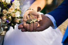 Bride and groom holding lock in their hands Royalty Free Stock Photos