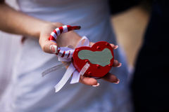 Bride and groom holding lock in their hands Stock Photography