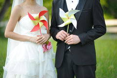 Bride and groom holding pin wheel Royalty Free Stock Image
