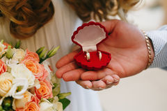 Bride and groom holding ring box. Bride and groom holding a ring box Stock Photography