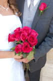 Bride and Groom Holding Roses Royalty Free Stock Photos