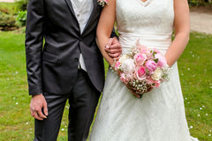 Bride and groom. A groom holding bride's arm Royalty Free Stock Photography