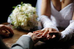 Bride and groom holding their hands Stock Photography
