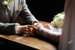 Bride and groom holding their hands Royalty Free Stock Photo