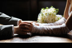 Bride and groom holding their hands Royalty Free Stock Photography
