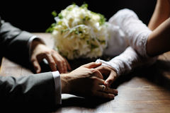 Bride and groom holding their hands Royalty Free Stock Images