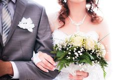 Bride with groom holding wedding bouquet Stock Photos