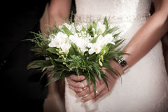 Bride with groom holding a wedding bouquet Stock Images