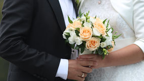 Bride with groom holding wedding bouquet Royalty Free Stock Photography
