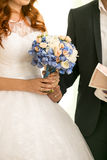 Bride and groom holding wedding bouquet Royalty Free Stock Photos
