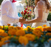Bride and groom holding wedding bouquet Royalty Free Stock Image