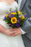 Bride and groom holding a wedding bouquet Royalty Free Stock Photo