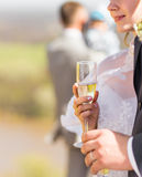 Bride and groom holding wedding champagne glasses Stock Image