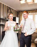 Bride and groom holding wedding champagne glasses Stock Photo