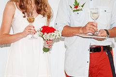Bride and groom holding wedding glasses with champagne. Married couple drinking a champagne Stock Image