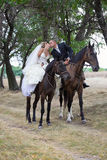 Bride and groom  on the horses Royalty Free Stock Photography
