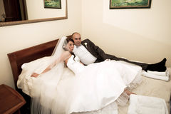 Bride and groom in the hotel bed Stock Image