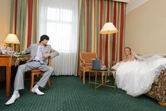 Bride and groom in hotel room Royalty Free Stock Photo