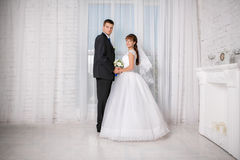Bride and groom are in the hotel room stock photography