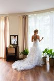 Bride and groom in a hotel room Stock Photography