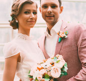 Bride and groom in hothouse Stock Photography