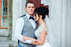 The bride and groom hug each other. stock photo