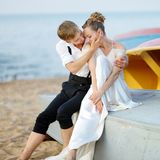 Bride and groom hugging on a beach Stock Images