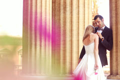 Bride and groom hugging in the city Royalty Free Stock Photography