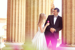 Bride and groom hugging in the city Stock Photography