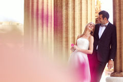 Bride and groom hugging in the city Stock Photos