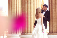 Bride and groom hugging in the city Stock Image