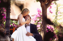Bride and groom hugging in the city Stock Photo