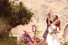 Bride and groom hugging in the city Stock Images