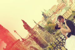 Bride and groom hugging in the city Royalty Free Stock Image