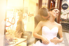 Bride and groom hugging in the city Royalty Free Stock Images