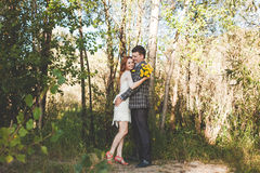 The bride and groom hugging each other in the forest Royalty Free Stock Photos