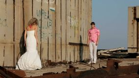 The Bride And Groom Hugging Each Other. The bride and groom running towards each other and hug when meeting stock footage