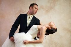 Bride and groom hugging in empty room Royalty Free Stock Photography