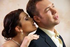 Bride and groom hugging in empty room Stock Photos