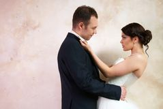 Bride and groom hugging in empty room Royalty Free Stock Photo